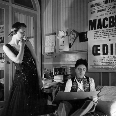 808273~Jean-Cocteau-Sketching-Model-Elizabeth-Gibbons-in-a-Chanel-Dress-in-His-Hotel-Bedroom-Posters